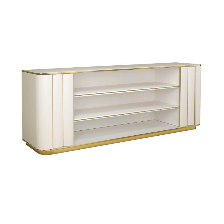 Designed by IC and beautifully crafted by Italian artisans, the Duilio bookcase features an open compartment with two large shelves embraced by ribbed doors on the sides. The brass, or powder coated metal, details and a stunning design will bring