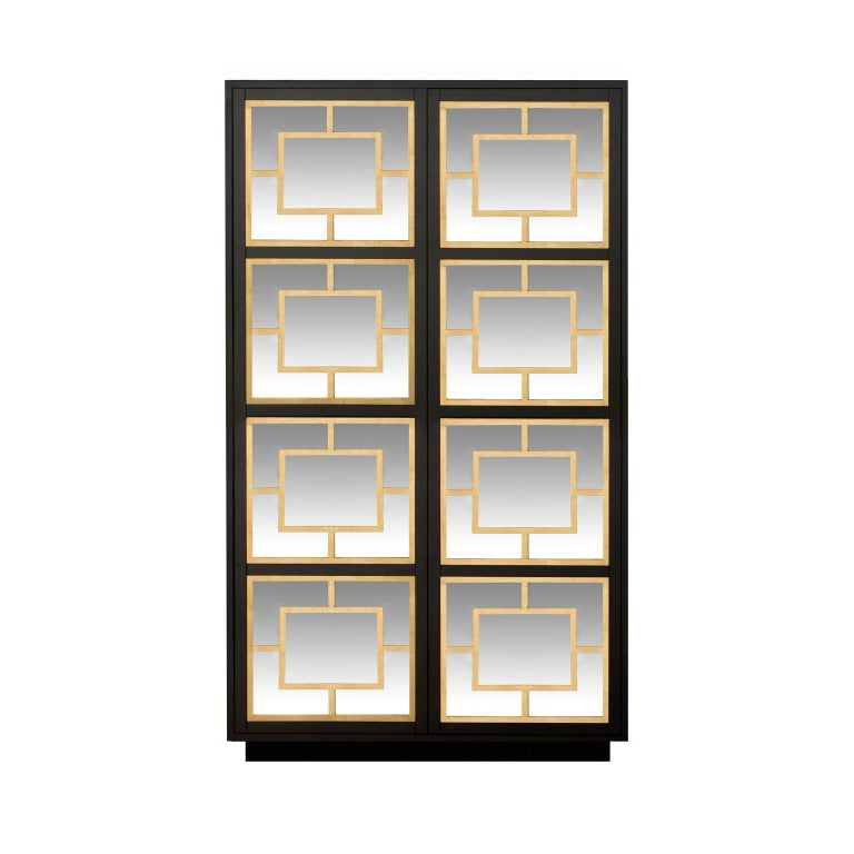 Designed by IC and handcrafted by expert Italian artisans, the cabinet features two mirrored doors with push-to-open mechanism, overlaid with gold leaf decorations.