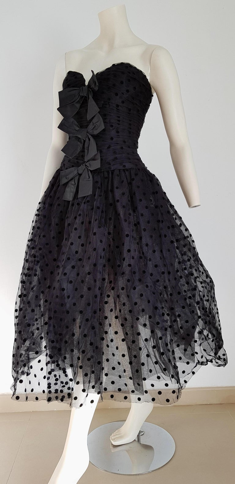 Isabelle ALLARD Paris, black velvet polka dots, plumetis black fabric, three knotted front ribbons, slightly transparent skirt, strapless dress - Unworn, New.  Isabelle ALLARD is a fashion designer that created only haute couture and selling to