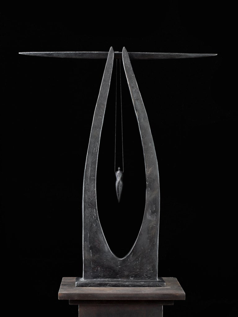 "Isabelle Thiltgès ""Détachement"" is a 60 x 52 cm figurative bronze sculpture. A small figurine is hanging from two side curved pillars, almost as a circus artist playing on a trapeze. The sculpture is monumental and intimate at the same"