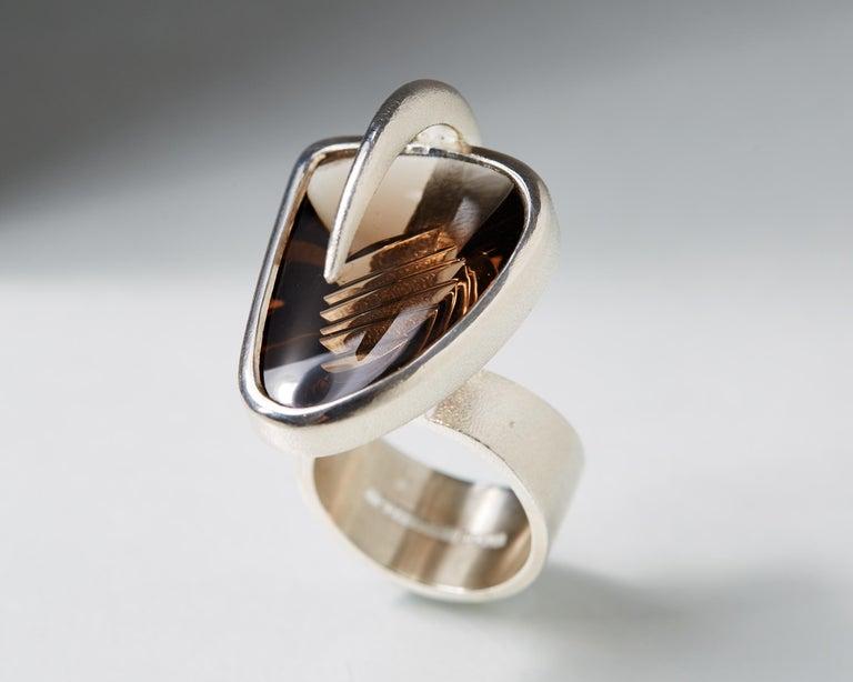Sterling silver and smokey quartz.  Size US: 7 Size EU: 55