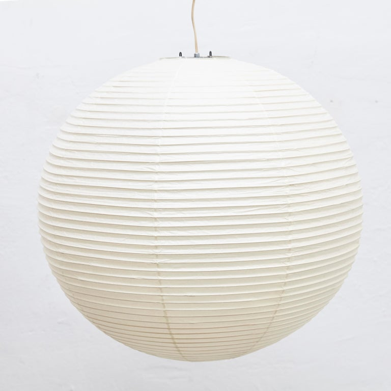 Ceiling Lamp, designed by Isamu Noguchi. Manufactured by Ozeki & Company Ltd. (Japan.) Bamboo ribbing structure covered by washi paper manufactured according to the traditional procedures.  In good vintage condition.  Edition signed with