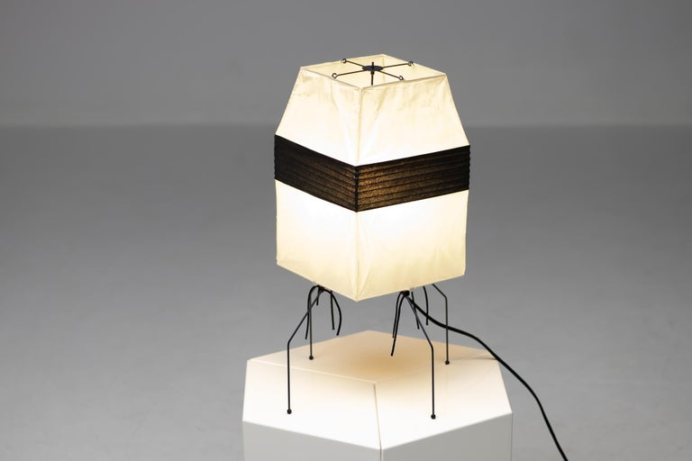 Model number UF 1-H table lamp in black and white by Isamu Noguchi for Akari. Designed and manufactured in Japan. 