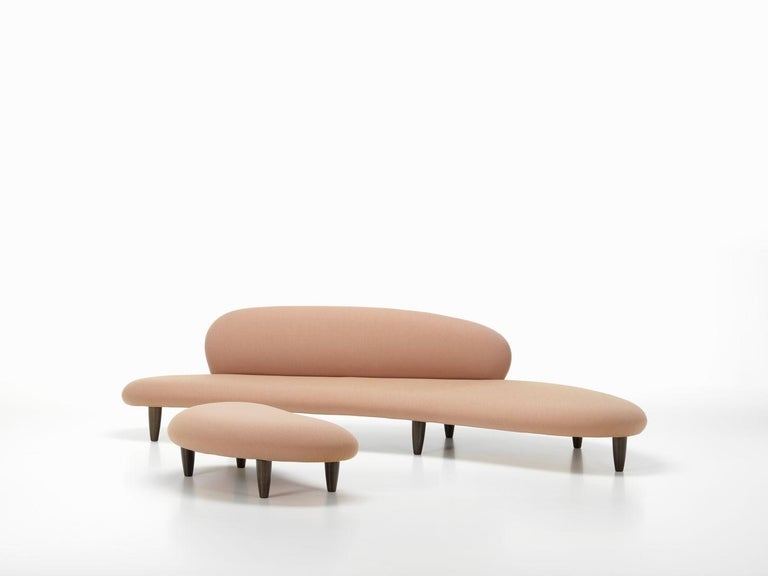 Sofa and ottoman designed by Isamu Noguchi in 1946. Manufactured by Vitra, Switzerland.  Designed by Isamu Noguchi, the Freeform Sofa has a thin – but comfortable – layer of upholstery padding that enhances its air of lightness and dynamic
