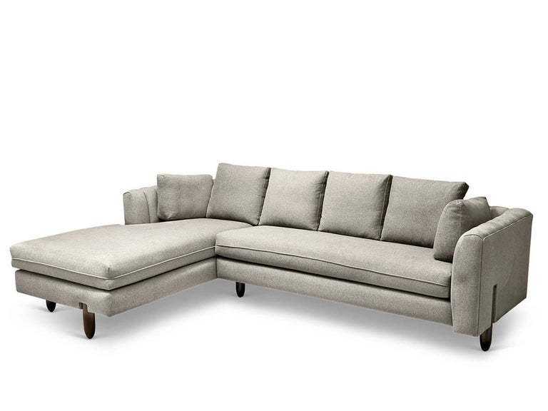 The Isherwood sectional features a channel tufted body with loose bolster cushions. The turned legs are made of solid white oak or American walnut and are inset on the sides revealing the leg detail.  The Lawson-Fenning collection is designed and
