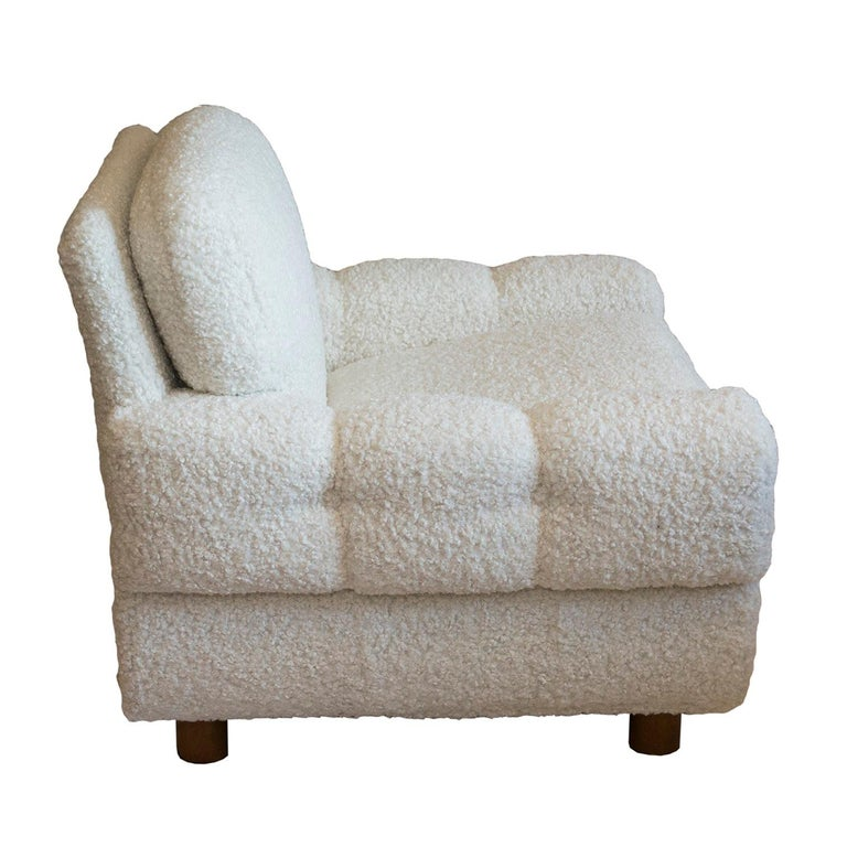 The look of these chairs is reminiscent of Paul Frankl's station wagon series. The oversized arms give these chairs their unique character. The faux shearling marries well with the Scandinavian design. An interesting element is the unique system of