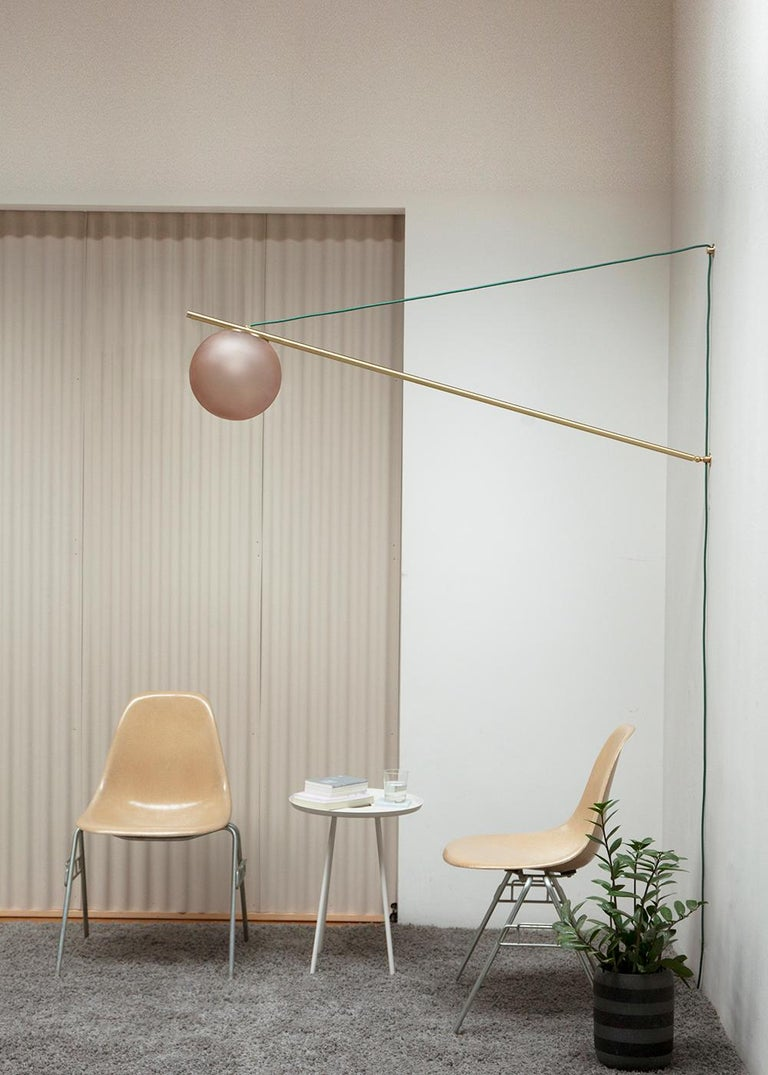 Iso began with consideration towards a common problem: how to create impactful, functional overhead lighting without a ceiling electrical box. Addressing this challenge with three simple elements, Iso's single rotating armature elegantly cantilevers