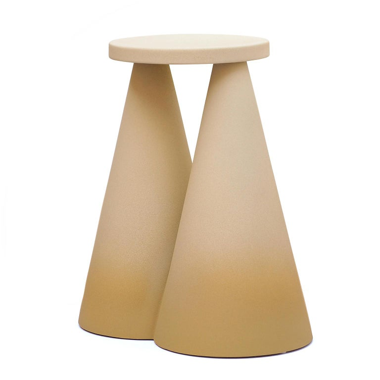 Isola side table is completely made in ceramic using high temperature furnace, to make the material stronger. The large base makes the object stable as well as unique on its design. Each piece is then finished by playing with the contrast between