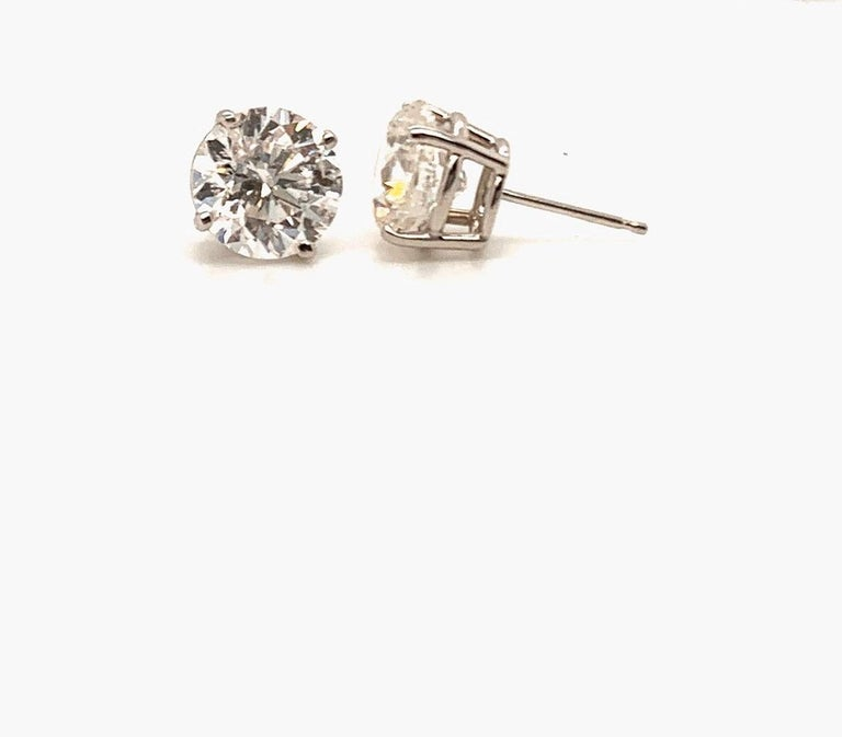 Super White Face Diamond Stud Earrings  These spectacular earrings are set in hand made platinum in a four prong mounting, The delicate craftsmanship on these stunners result in a remarkable setting allowing the full brilliance of the