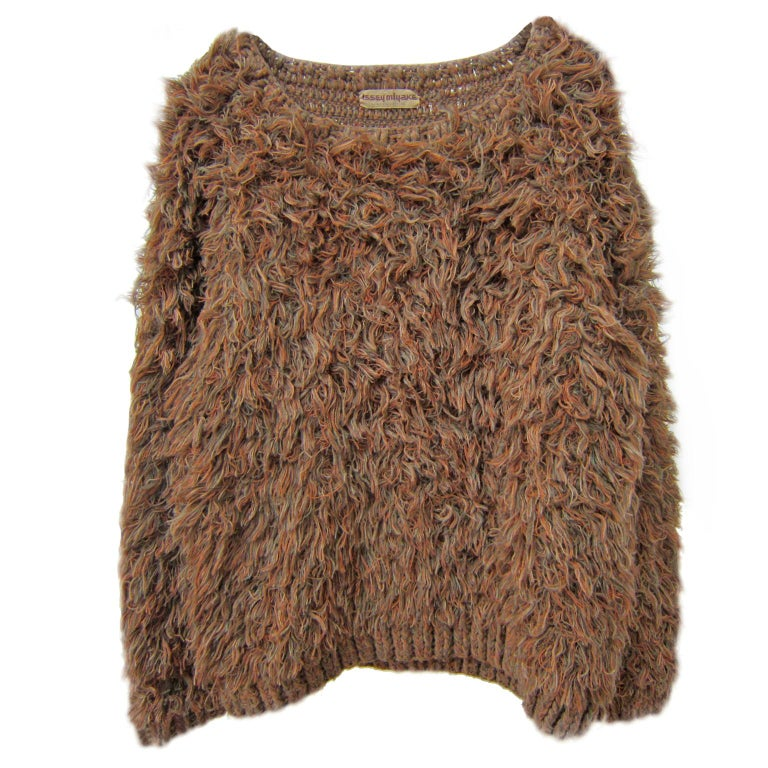 Early Issey Miyake long hair knit sweater from 1980s. Made with crochet technic brown tan orange / blue mixed yarns. Measurements : Width : 60 cm Length : 66 cm Sleeve : 79 cm