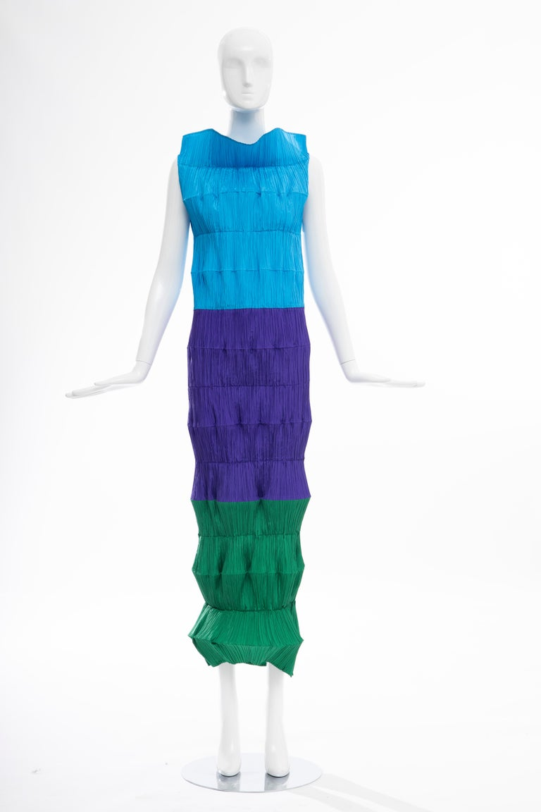 An Issey Miyake 'Flying Saucer' dress, Spring-Summer, 1994, labelled and size M, composed of concertina-pleated discs of brightly coloured polyester, with slits for the arms Similar 'Flying Saucer' dresses were included in the 'Issey Miyake: Making