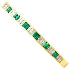 Italian 1.35 Carat Emerald 2.31 Carat Diamond Gold Bangle, circa 2000