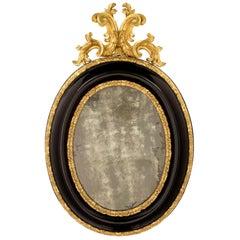 Italian 17th Century Giltwood and Ebonized Fruitwood Florentine Mirror