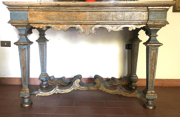Elegant Italian 17th century light blue painted and parcel-gilt console tables with a marble top.