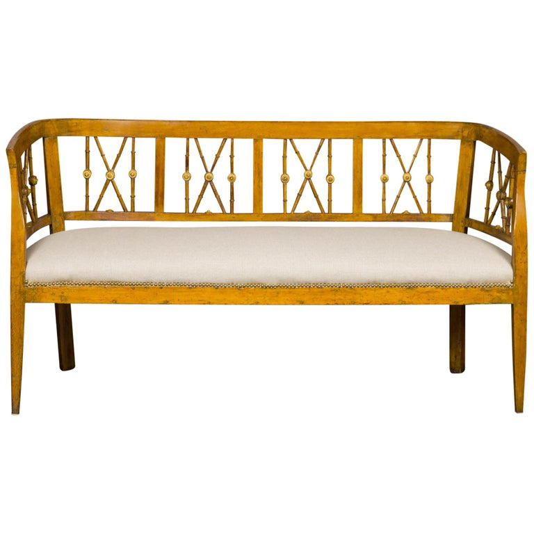 Italian 1820s Walnut Settee with Pierced Back, X Motifs and Gilded Medallions