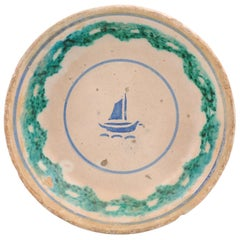 Italian 1895 Pottery Platter with Blue Sailboat Motif and Weathered Patina