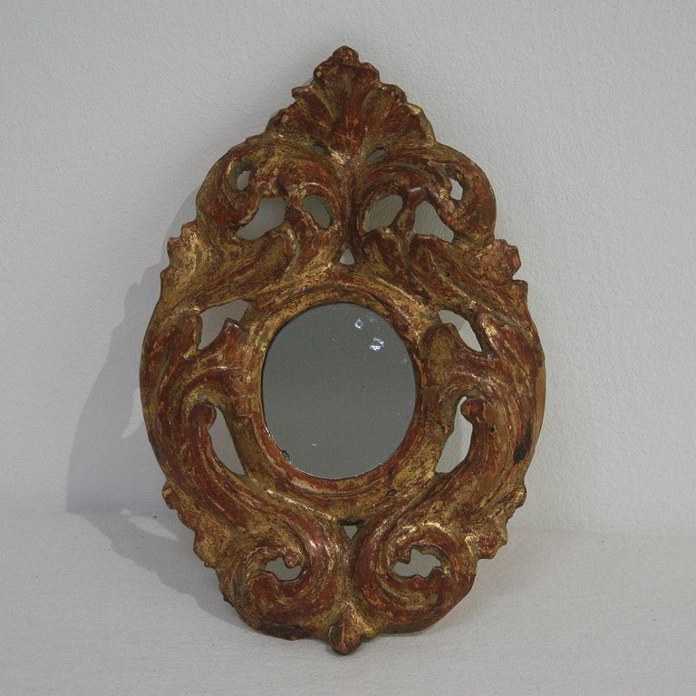 Unique and beautiful miniature mirror with its original gilding, Italy, circa 1750. Weathered.