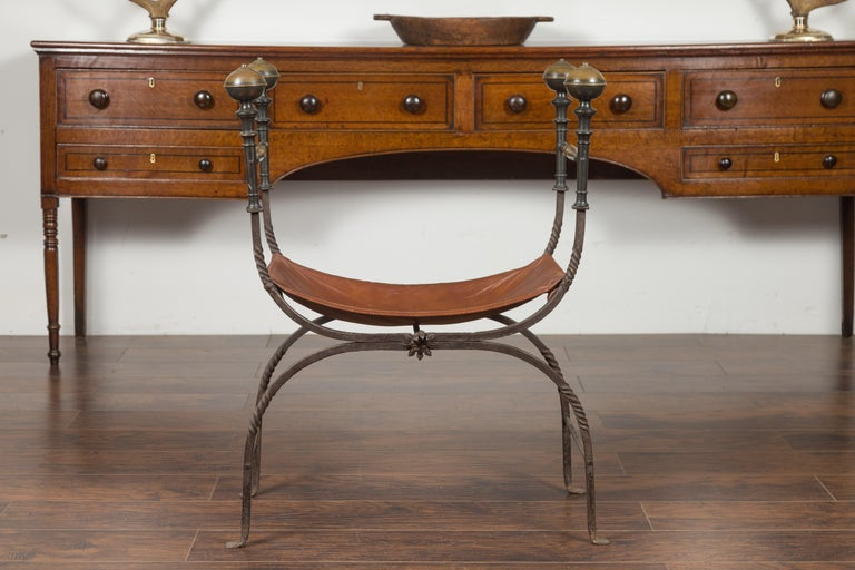 Italian 1900s Leather Seat Iron Folding Curule Stool with Toupie Finials For Sale 9