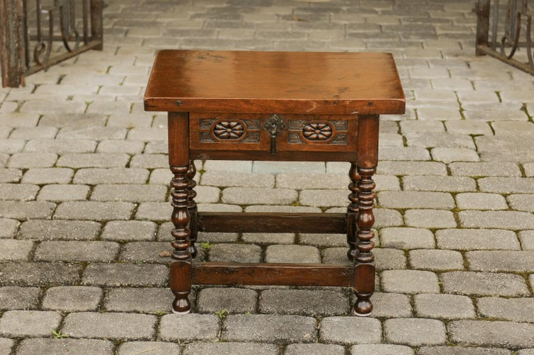An Italian walnut side table from the early 20th century, with single drawer, floral décor and turned legs. Born in Italy during the early years of the 20th century, this lovely walnut side table features a rectangular top, sitting above a single