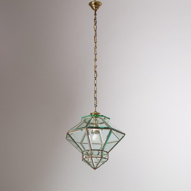 Fine Italian lantern with faceted glass from the 1940s. Unique octagonal gemstone cut shape with thick faceted glass elements inserted into a brass frame. Nice original condition with a light patina on the brass, heavy patina on the original iron