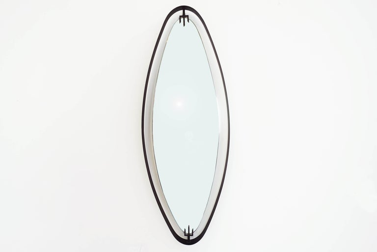 Italian design and production 1950 Clip-on black arrow detail for the suspended glass mirror.
