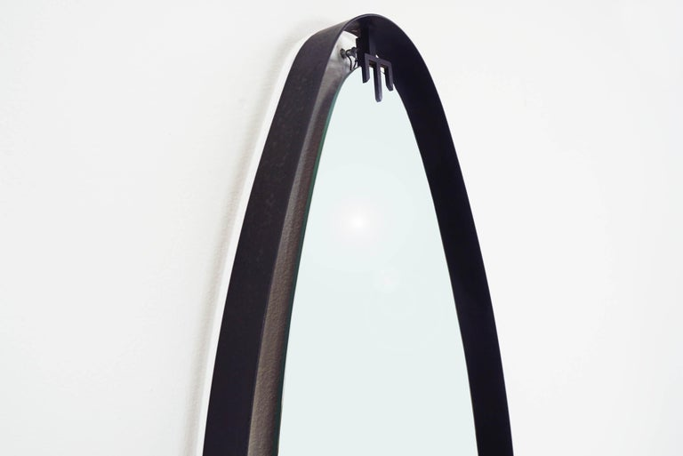 Mid-Century Modern Italian 1950 Suspended Oval Wall Mirror with Black Metal Ribbon Clip-On Arrow For Sale
