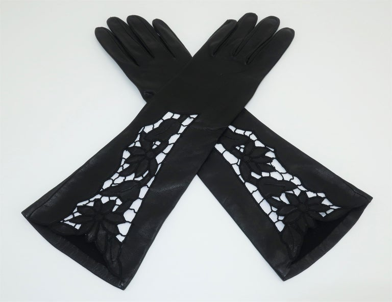 A beautiful pair of gloves is the ultimate in glamour and style. These black leather gloves are 3/4 length with intricate embroidered cut work at the cuff.  A white insert was used in the photographs to show the detail though when worn the cut work