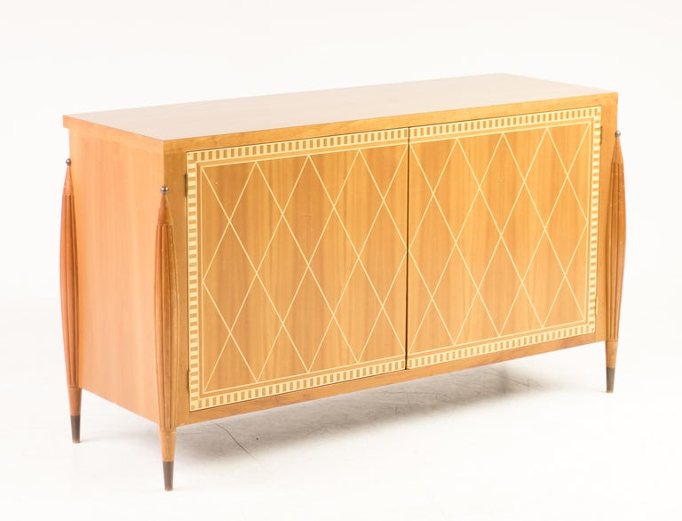 Italian Mid-Century Modern cabinet with beautiful modern marquetry in European walnut and sycamore. Delicately sculpted legs with brass details. Exceptional piece. The shelves are no longer present, but new shelves can be made upon
