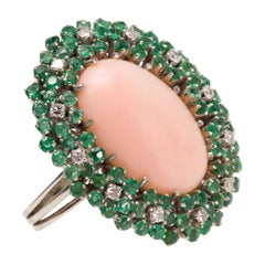 Italian 1950s Cabochon Angel Skin Coral, Emeralds and Diamond Cocktail Ring