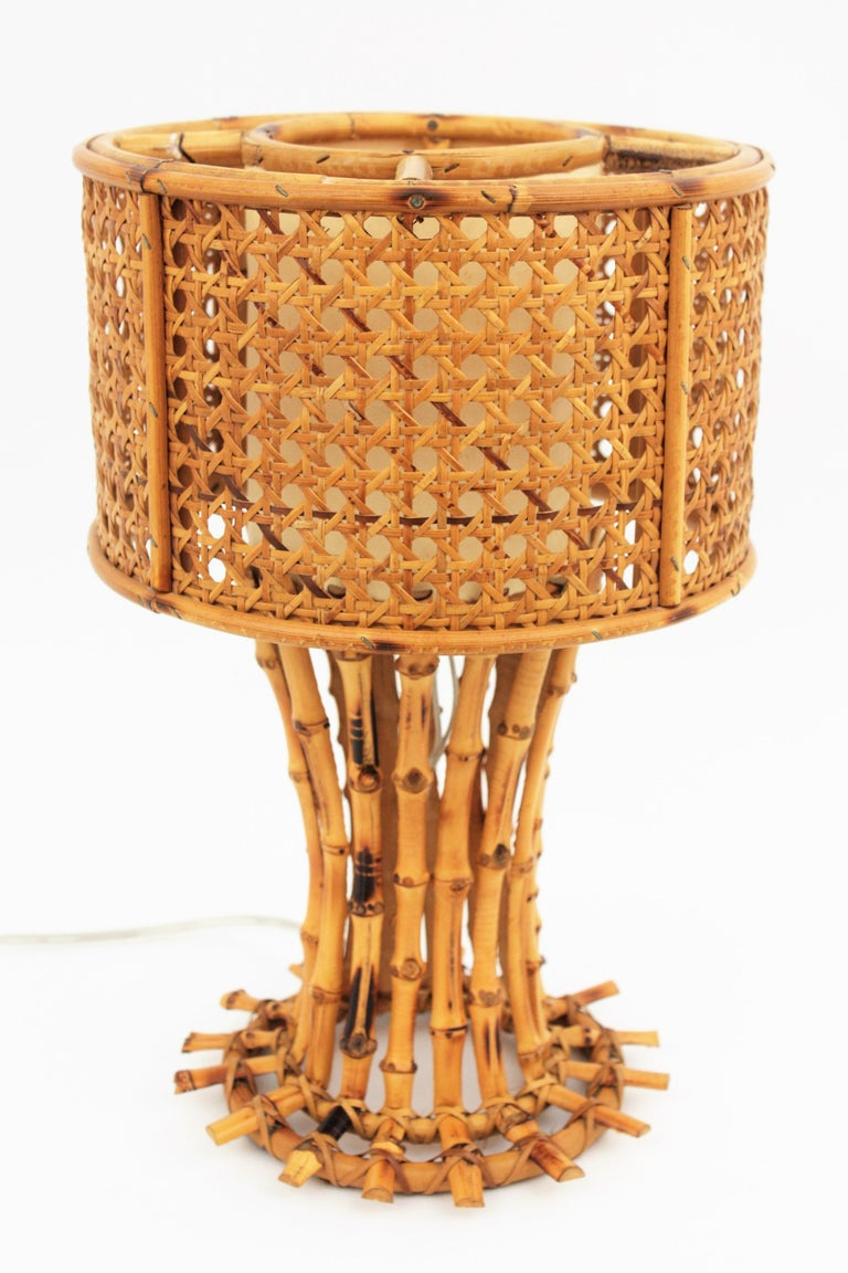 Sculptural bamboo table lamp with a woven wicker circular shade and an inner paper shade to diffuse the light. Handcrafted in Italy at the mid-20th century period with chinoiserie oriental accents. Newly wired with an E27 bulb.