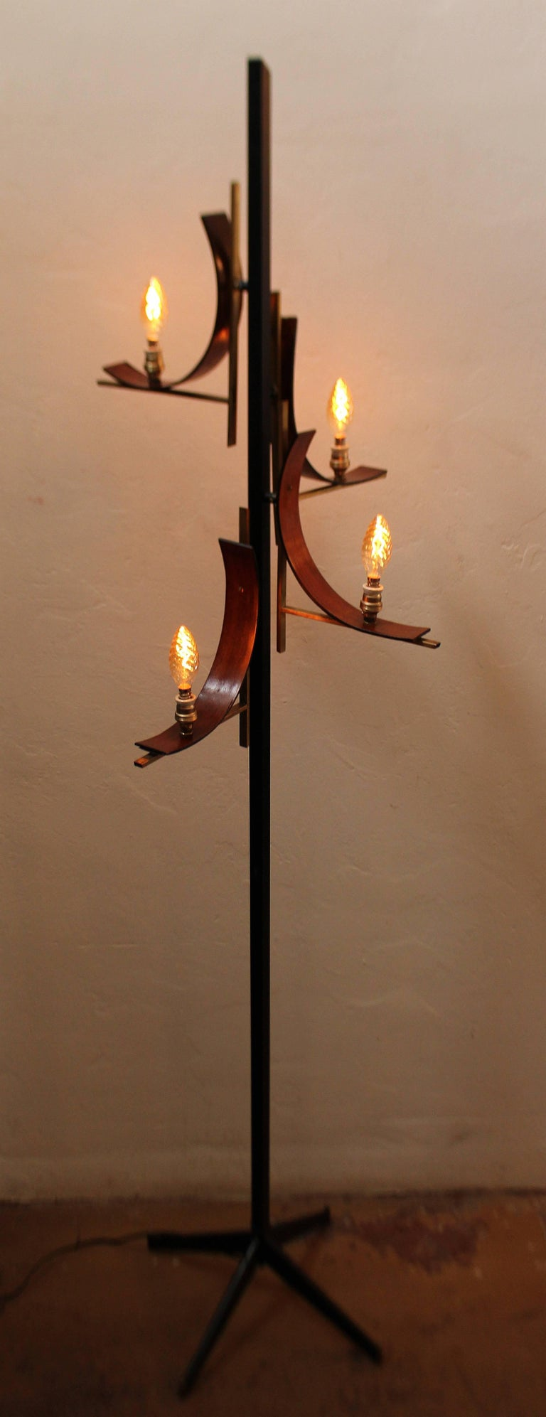 Italian floor lamp in style of Stilnovo .Metal base with the wood and brass and brass and ceramic bulb socket.