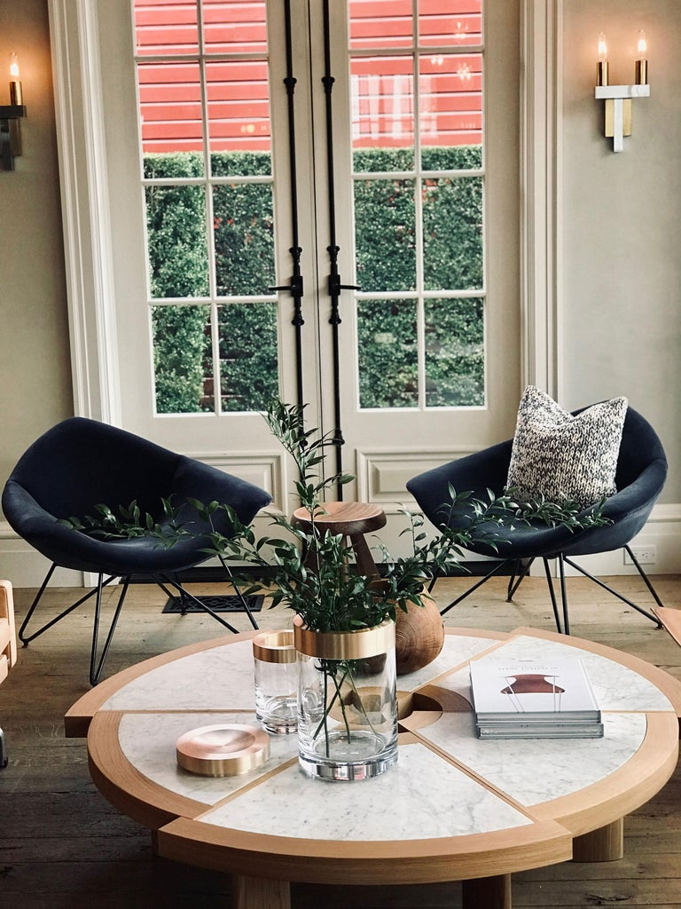 Designed by Augosto Bozzi and manufactured by Saporit Italia these iconic pair of Italian chairs have a metal base and re-upholstered in a beautiful blue velvet fabric.
