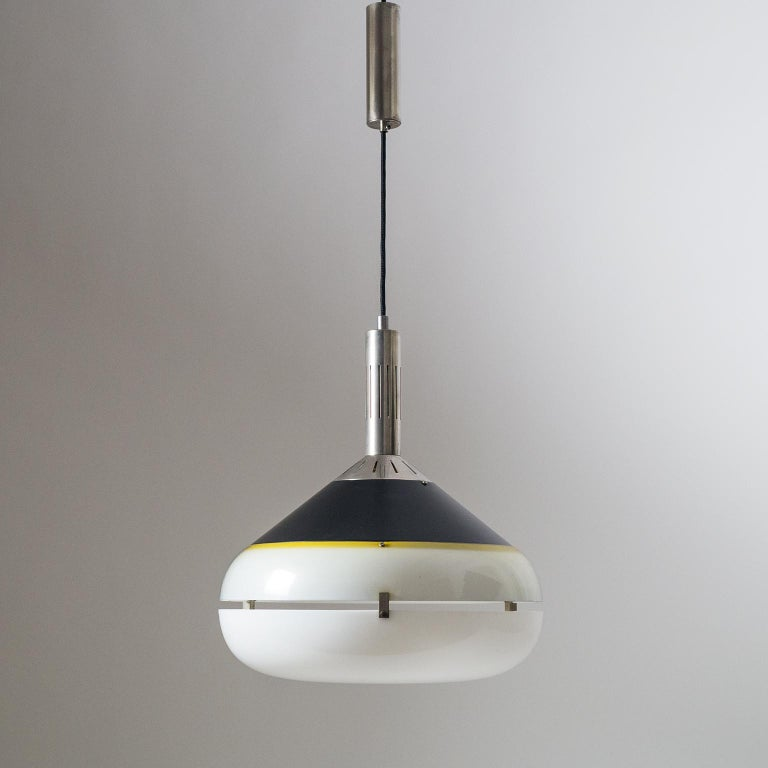 1950s Italian pendant attributed to Stilux. Slim nickeled brass hardware with a black lacquered shade and dual acrylic diffusers. Fine original condition with a light patina on the nickel and light scratches on the rims of the acrylic diffusers. One