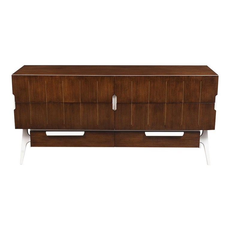 This 1970s Italian Modernism credenza has been completed restored and newly stained in walnut and white color combination with lacquer finish. This credenza features four large drawers with brass details and hidden carved handles underneath the
