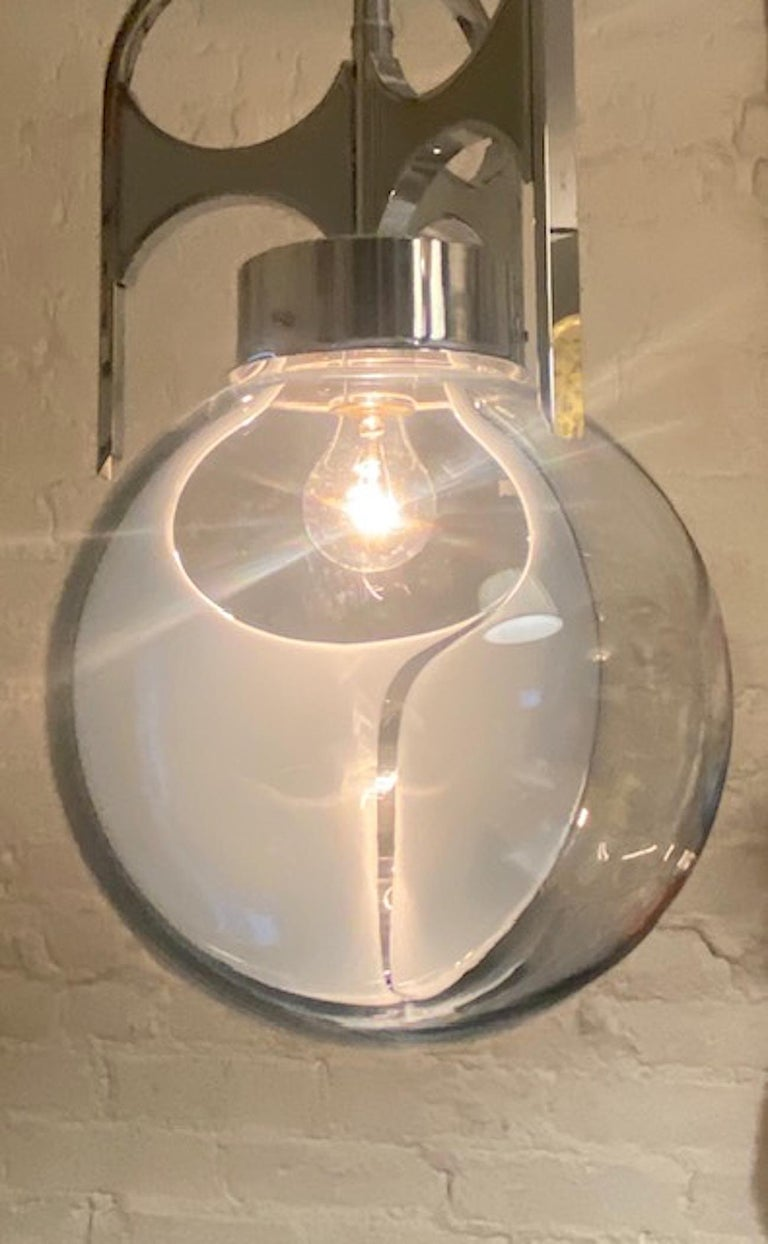 Italian 1970s Chrome with Clear and White Glass Globe Pendant Light In Good Condition For Sale In New York, NY