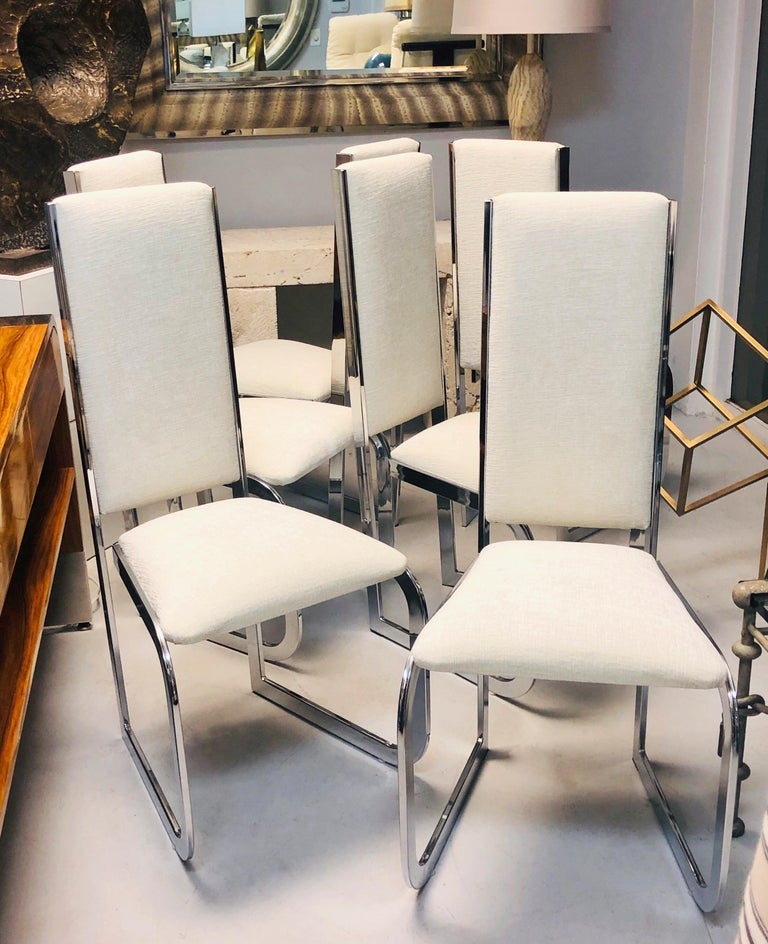 Super chic set of chairs. Simple frames, with cantilevered seats. Note how the frames are wider at the front echoing the shape of the trapezoidal seat.