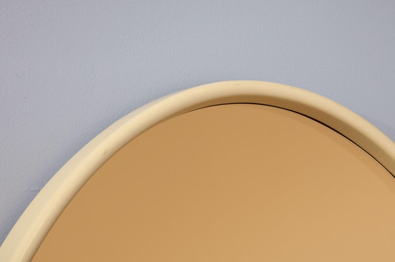 Late 20th Century Italian 1970s Lacquered and Rose Gold Glass Oval Mirror For Sale