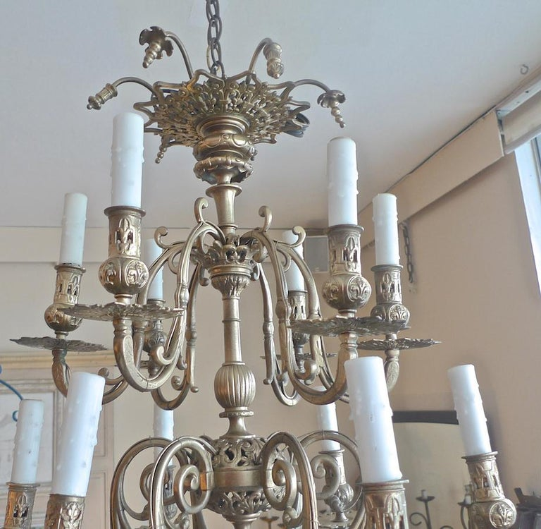 Italian, 19th century bronze chandelier with two tiers and six lights each tier.