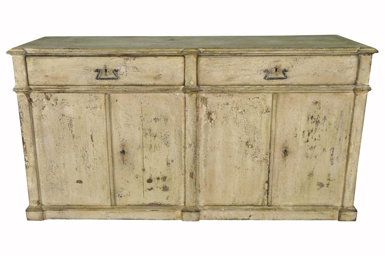 A very handsome early 19th century buffet or credenza from Northern Italy. Soundly constructed from painted wood with 4 doors and 2 drawers. Terrific patina and color. Great storage piece.