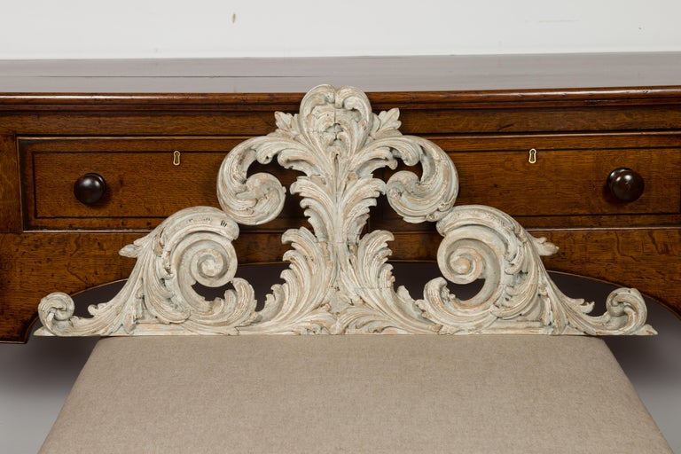 An Italian carved and painted architectural fragment from the 19th century, with volutes and acanthus leaves. Created in Italy during the 19th century, this carved fragment attracts our attention with its sinuous scrolling lines accented with carved