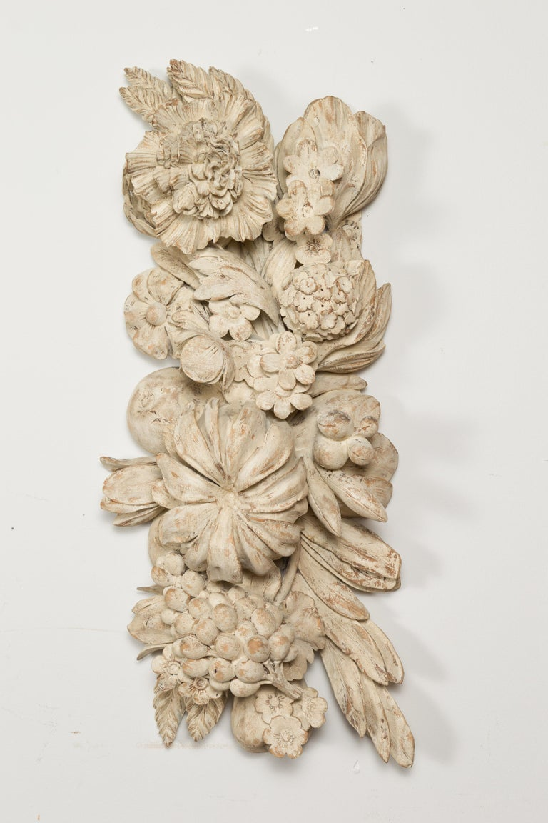 An Italian carved wooden fragment from the 19th century, depicting large fruits and flowers. Created in Italy during the 19th century, this wall fragment features large flowers and fruits on foliage arranged in a joyous composition. Accented with a