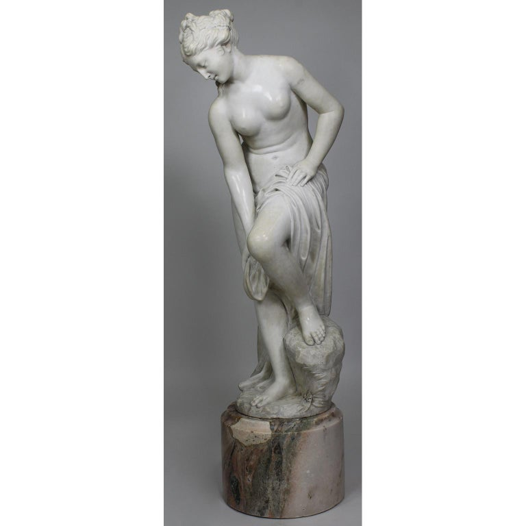 "A very fine Italian 19th century carved white marble Greco Roman style figure of ""The Bather"" – ""Bathing Venus"" - ""Venus After the Bath"", after the original model by Christophe-Gabriel Allegrain (French, 1710-1795). This model has been a popular"