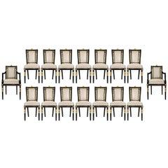 Italian 19th Century Louis XVI St. Set of Sixteen Ebony and Giltwood Chairs