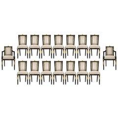 Italian 19th Century Louis XVI Style Set of Sixteen Ebony and Giltwood Chairs