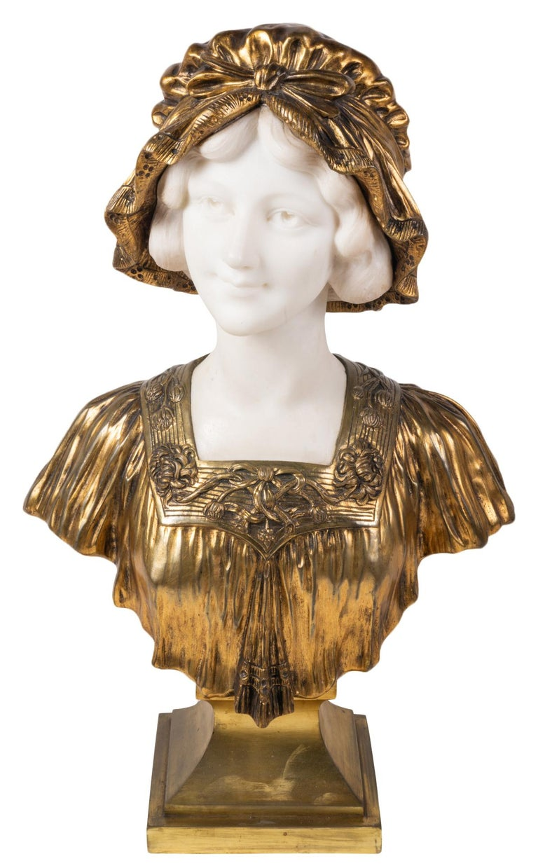 A classical 19th century Italian marble and gilded bronze bust of a pretty young girl wearing a bonnet,