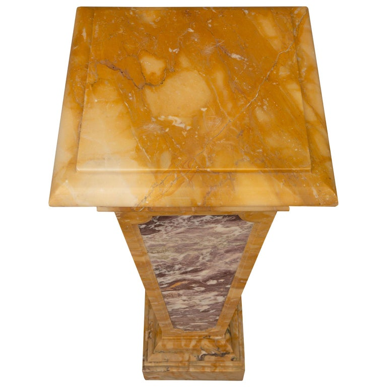 A most impressive Italian 19th century neoclassical St. Brèche Violette and Sienna marble pedestal column. The pedestal is raised by a fine square base with an elegant and most decorative stepped design. The square tapered central support displays