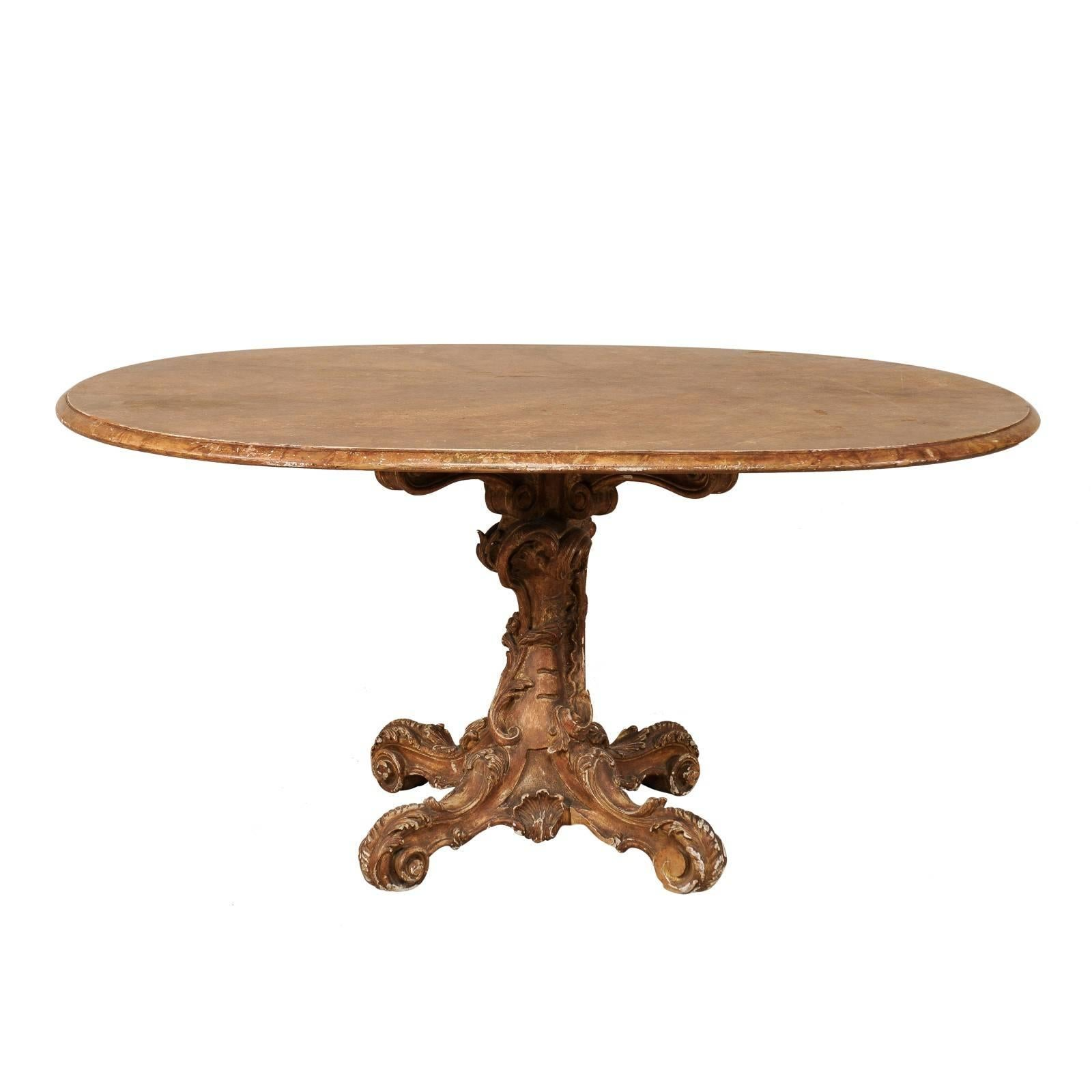 Italian 19th Century Oval Pedestal Table With Carved Wood Base In Warm Hues  For Sale