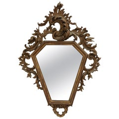 Italian 19th Century Rococo Style Carved Mirror with Traces of Gilt and Scrolls