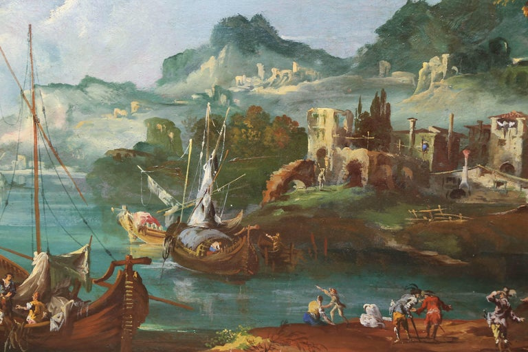 Serpentine form painting in original giltwood frame Depicting a harbor scene of boats, village people and Their homes and surroundings.
