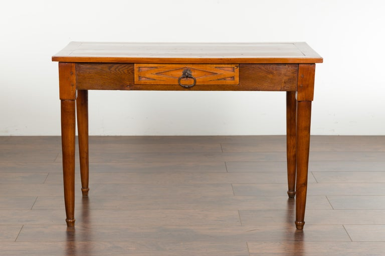 An Italian walnut console table from the 19th century, with single drawer and diamond motif. Created in Italy during the 19th century, this walnut table features a rectangular top sitting above a single dovetailed drawer. Carved in low-relief with